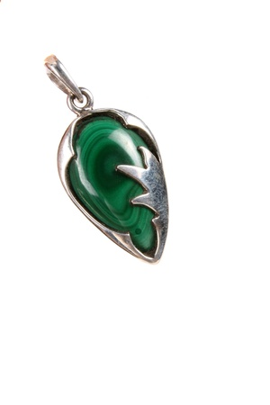 malachite: A beautiful pendant made of a malachite gemstone believed to protect children, isolated on white studio background.