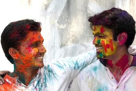 Two friends enjoying the colorful holi festival in India