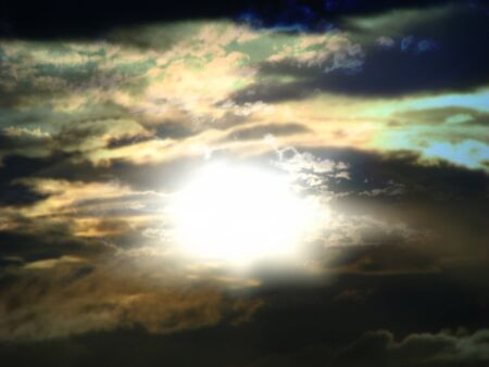 A background of a heavenly and mysteriously colored sky with a divine light at the center  Stock Photo - 12812054