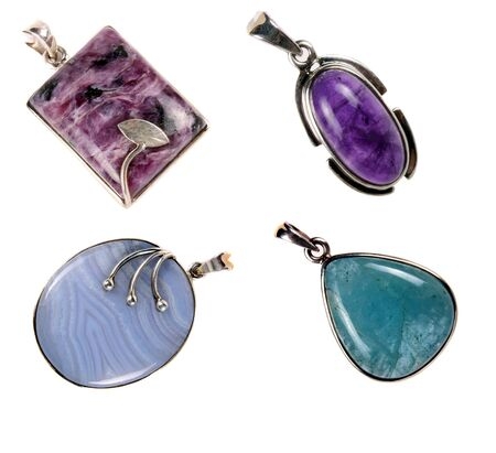 precious stone: A set of silver pendants having amethyst, aquamarine, blueless and chorite stones  Used as jewelery or for alternative therapies, isolated on white studio background