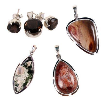 A set of silver pendants having mosagate, petriwood and smoky quartz stones  Used as jewelery or for alternative therapies, isolated on white studio background Stock Photo - 13524759