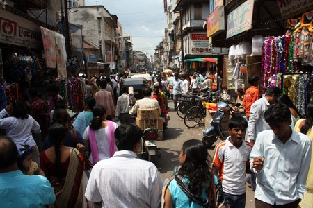 People shopping in an Indian market during the Diwali festival