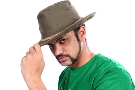 A cool Indian guy wearing a hat, on white studio background  photo