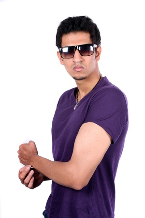 A portrait of a handsome young Indian man showing off his biceps, isolated on white studio background  photo