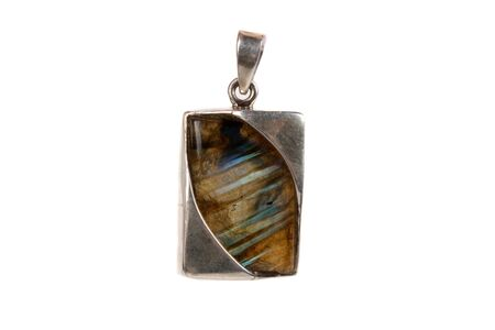 labradorite: A labradorite pendant made of silver used as jewelery or in alternative therapies like crystal healing and astrology, isolated on white studio background