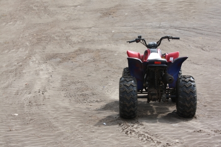 buggy: A beach buggy without a rider, on the beach sands
