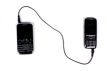 qwerty: A metaphorical image of the connectivity in between and old cellphone and a new QWERTY smartphone