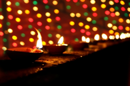 festival occasion: Beautiful clay lamps lit in a line on the occasion of Diwali festival in India  Stock Photo