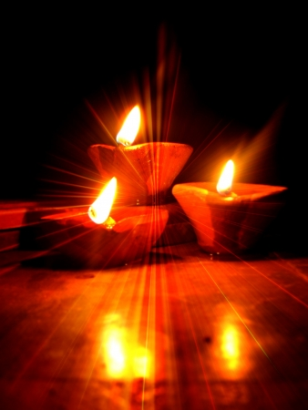 Traditional holy lamps lit during Diwali festival with a spiritual glow  photo