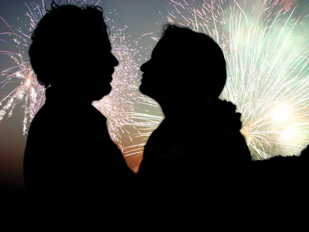 A silhouette of a romantic Indian couple against the fireworks celebration during Diwali festival in India  photo