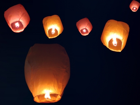 Beautiful chinese sky lanterns floating in the sky on occassion of an Indian festival.                                Stock Photo