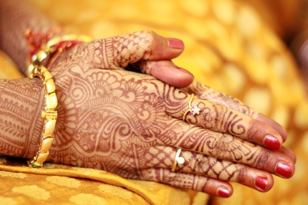 The hands of a hindu bride decorated with mehendi henna in the position of a prayer  Stock Photo