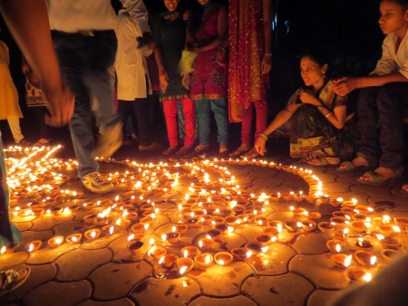 People from India light up traditional earthen lamps on the occassion of Diwali festival celebrations