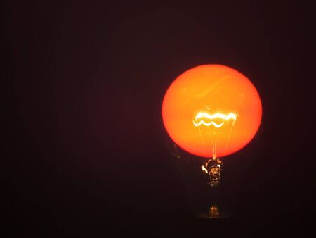 metaphorical: A metaphorical image of a light bulb powered by the Sun