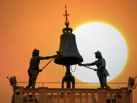 clocktower: The sun setting behind the St Marks Clocktower in Venice.
