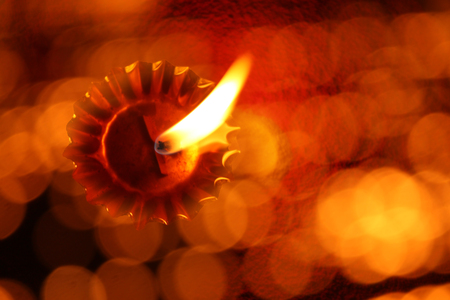 deepawali: A unique traditional Diwali lamp image with an abstract view of a lit lamp through a line of blur lights