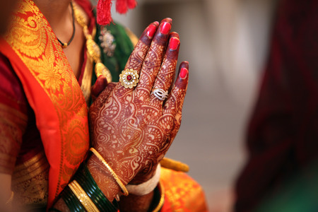 Folder hands of a traditional Indian bride in wedding attire, praying during her wedding. Stock Photo