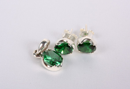 ear ring: A set of pendant and earring made of silver and green gemstones.