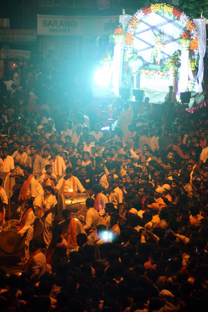 ganapati: Thousands of people gather and dance in front of one of the Ganesh idol processions on the occassion of Ganesh festival in India.