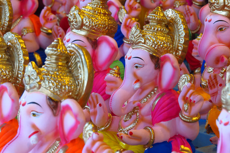 ganesh idol: Newly made idols of the Elephant God known as Ganesha or Ganapati for sale at a shop on the eve of Ganesh festival in India.