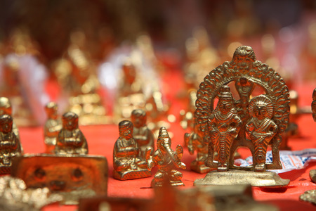 deities: The brass idols of lord Vitthal and Rakhumai along with other deities for sale in a holy shop in India.