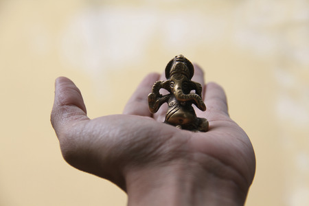 lord ganesha: A beautiful antique brass idol of lord Ganesha held in the hand for luck