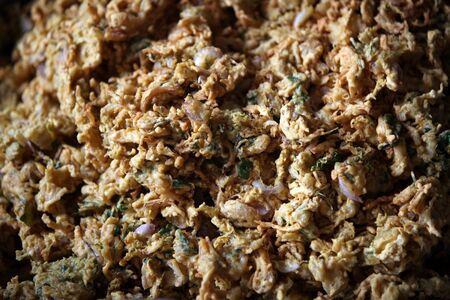 onion bhaji: A background of delicious favorite Indian delicacy called Kanda Bhaji which are Onion Pakodas