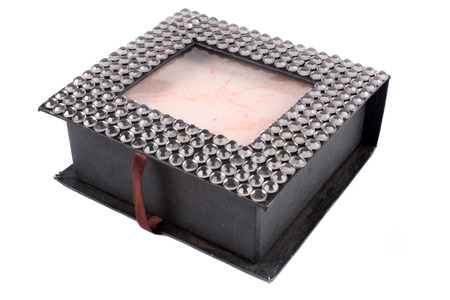 decorated: A custom made jewelery box decorated with beads, on white studio background.