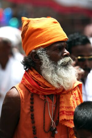 old asian: An elderly Indian pilgrim in traditional Hindu clothes, during a huge pilgrimmage
