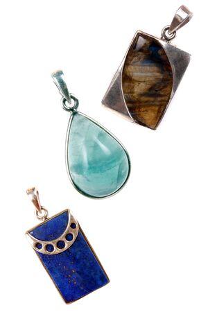 pendent: Silver pendants made of various semi precious gemstones, on white studio background Stock Photo