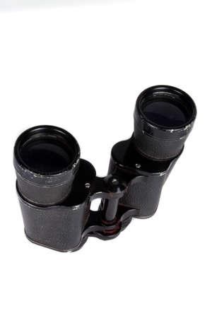 antique binoculars: A pair of antique binoculars used in World War 1, on white studio background. Stock Photo