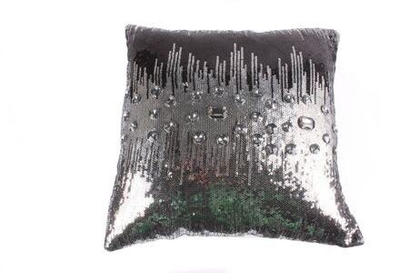 sequins: A luxurious pillow with a design of sliver sequins and glass beads, on white studio background Stock Photo
