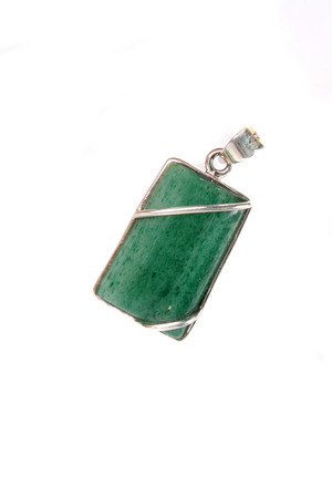 green gemstone: A silver pendant with a semi precious green gemstone, on white studio background. Stock Photo