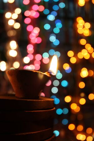 Traditional Diwali lamps in colorful blur festive lights during Diwali festival in India. Stock Photo
