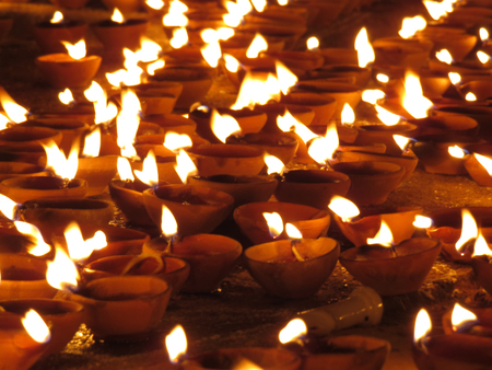 earthen pot: Traditional oil lamps in earthen pot lit up on the festive occasion of Diwali in India.