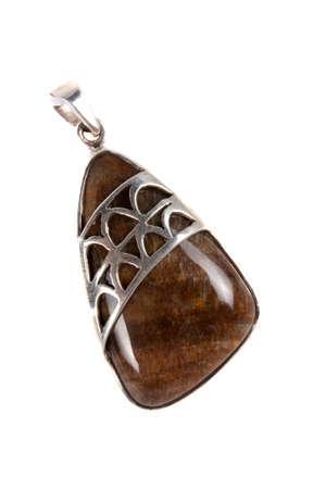 pendent: A designer pendant with a precious brown gemstone, on white studio background. Stock Photo