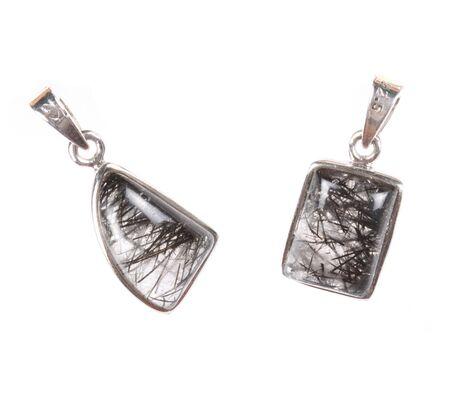 semi precious: A pair of pendants made of silver and semi precious gemstones, on white studio background