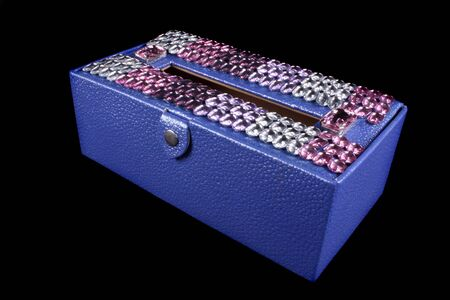 luxurious: A luxurious tissue box in violet color designed with gemstones.