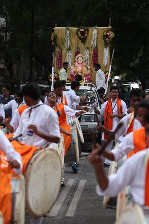 pune: Pune, India - September 17, 2015: Ganesh festival procession being traditionally celebrated Dhol Tasha percussion and dancing.