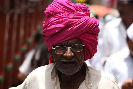 headgear: Pune, India - July 11, 2015: An old Indian pilgrim with a traditional headgear
