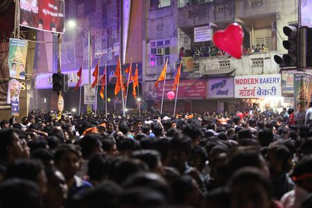 pune: Pune, India - September 28, 2015: Crowds at one of the square during Ganapati festival in India.