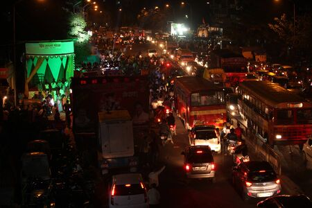 causing: Pune, India - September 27, 2015: Ganesh festival crowds on last day causing traffic jams in India.