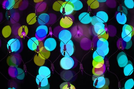 wire mesh: A wire mesh of colorful decoration light on the backdrop of other colorful lights