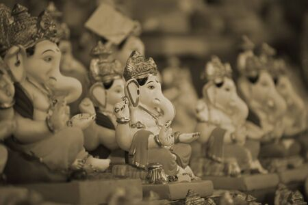 idols: Beautiful traditional lord Ganesh idols lined up during Ganesh festival in India.