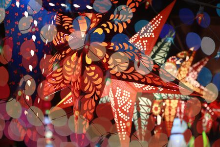 colourful lightings: Start shaped lantern line through the colorful blur decoration lights during an Indian festival Stock Photo