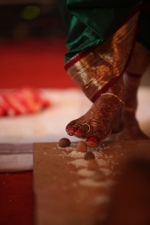 betelnut: The last steps of the bride among the 7 taken during a traditional hindu religious wedding consisting of a betelnut and rice.