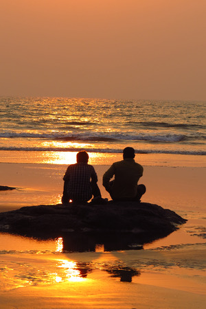 they are watching: Two friends watching the sea in the evening sadly as they bid farewell to their summer vacation
