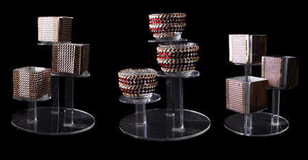 A set of designer candle stands with beautiful different designs studded with decorative stones. Stock Photo