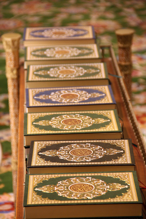 A line of holy Qurans in different cover designs at the grand mosque