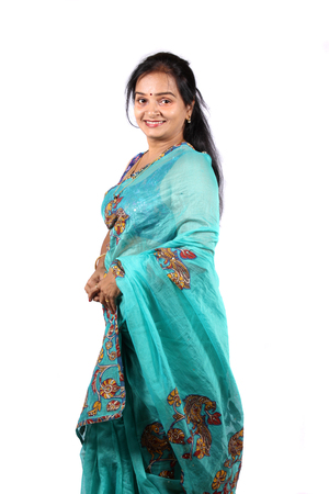 A beautiful Indian woman in a traditional saree, on a white studio background.